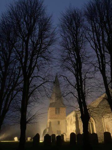 Misty church at night